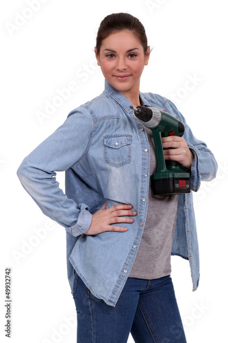 handywoman posing with a power drill