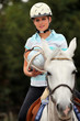 Young blond woman playing Horse ball