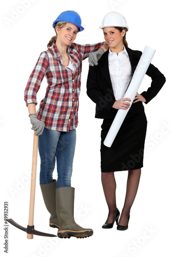 Blue collar worker standing next to an engineer