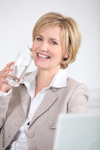 portrait of a businesswoman with glass of water