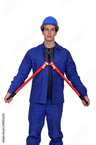 Man with a pair of long handled cutters