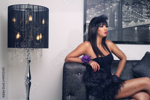 beautiful luxurious woman sitting & sensually posing
