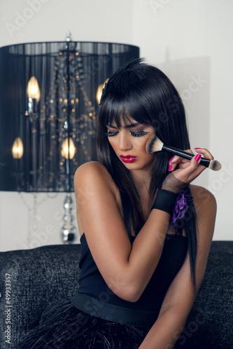 beautiful luxurious woman applying makeup