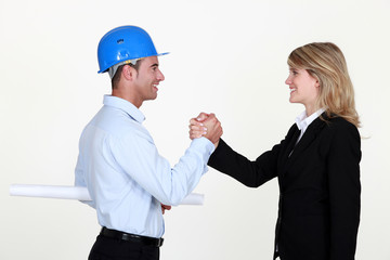 Two architects greeting each other
