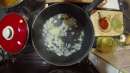 Cooking The Onions In A Pan