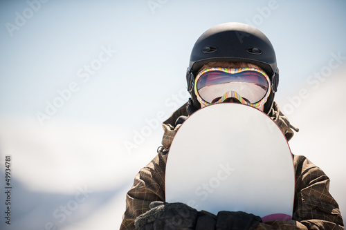 snowboard and  snowboarder - 49934781