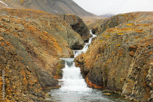 Arctic waterfall in rocks, Spitsbergen (Svalbard island)