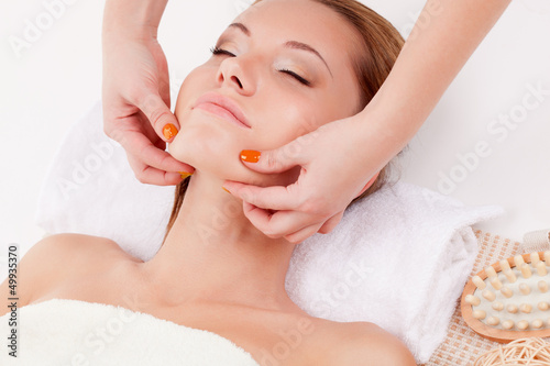 woman receiving chin massage