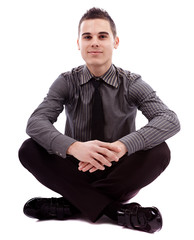 Full length of businessman sitting on the floor