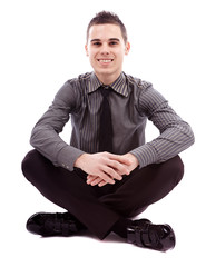 Full length of businessman sitting on the floor