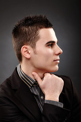 Profile closeup of young businessman