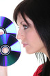a brunette woman and discs