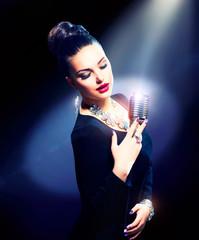 Singing Woman with Retro Microphone © Subbotina Anna