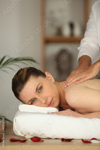 Woman having shoulder massage