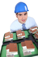 Architect holding an architectural model