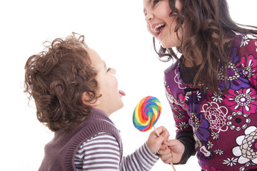 kids licking a lollipop on a white background