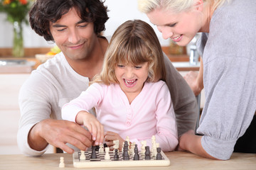 Father and daughter playing chess