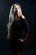 Sexy woman portrait - dark black background
