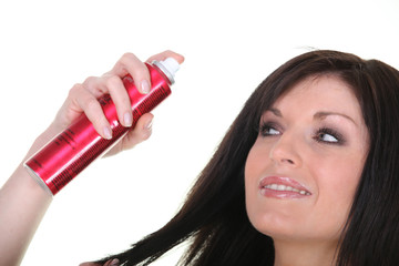 Woman with bottle of hairspray