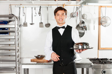 Young Waiter With Cloche Lid Cover And Tray