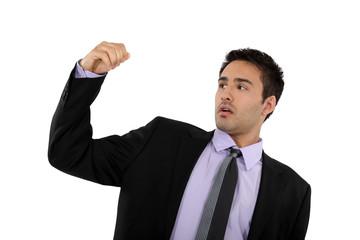 Successful businessman raising his fist