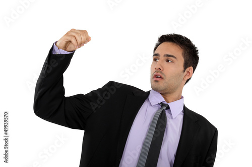 Successful businessman raising his fist