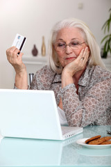 Elderly woman shopping on-line