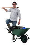Mason posing by his wheelbarrow