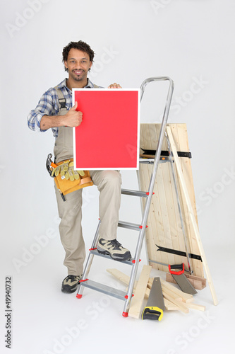 Carpenter with a board left blank for your message