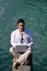 Man outdoors with laptop