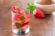 Strawberry mojito served with lime and crushed ice