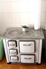 antique cast iron stove to heat the House in the mountains