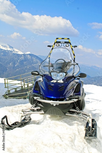 snowmobile parked in the mountain on the snow
