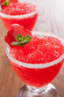 Strawberry slushie cups decorated with mint