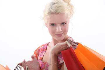 Blond woman carrying shopping bags
