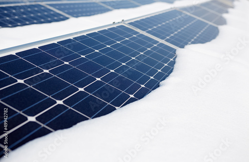 snow-covered solar panel - 49942782