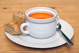 Bowl of tomatoe soup with brown bread