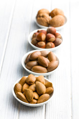 various nuts in ceramic bowls