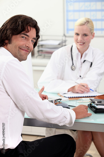 Man sitting at a doctor's desk