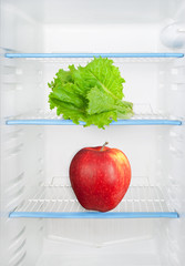 Lettuce and apple in the refrigerator