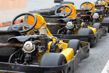 Yellow Go-kart in perspective row