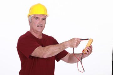 Man with a multimeter
