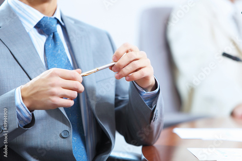 Hands of businessman laying on table