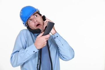 Man juggling several phone calls