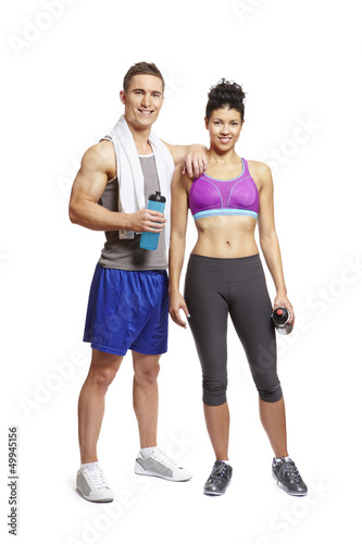 Young man and woman relaxing in sports outfits