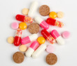 Close up colorful pills isolated on white