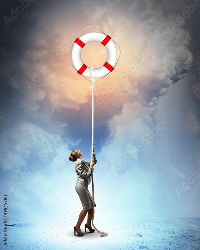 Image of businesswoman climbing the rope