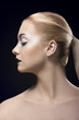 blonde girl in profile with dark lipstick