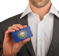 Businessman is holding a business card, New Hampshire