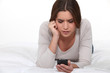 Woman reading disturbing text message